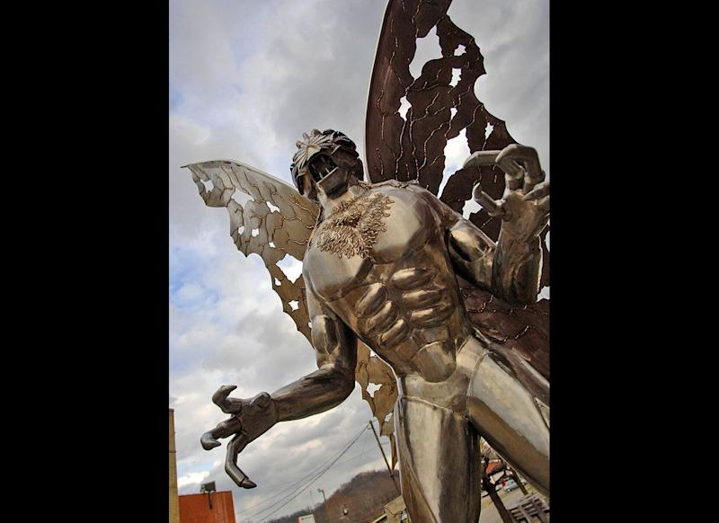 """A large Mothman sculpture stands along Main Street on Dec. 11, 2007, in Point Pleasant, W.Va. More than 40 years after the first reported sighting of the mysterious creature later dubbed """"Mothman,"""" residents here have embraced his legend, helping to turn the town into a destination for people in search of an offbeat tourism experience."""