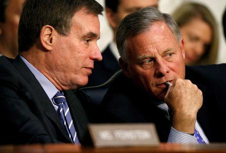 FILE PHOTO: Chairman of the Senate Intelligence Committee Richard Burr (R-NC) and ranking member Mark Warner (D-VA) talk during a hearing about Russian interference in U.S. elections in Washington, U.S., June 21, 2017.   REUTERS/Joshua Roberts/File Photo