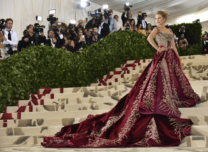 FILE - Blake Lively attends The Metropolitan Museum of Art's Costume Institute benefit gala celebrating the opening of the Heavenly Bodies: Fashion and the Catholic Imagination exhibition on May 7, 2018, in New York. Lively turns 33 on Aug. 25. (Photo by Charles Sykes/Invision/AP, File)