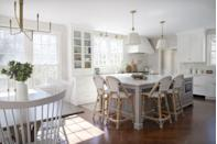 "<p>The white cabinets look so much fresher than the former wood material in this kitchen from <a href=""http://www.elementsofstyleblog.com/2019/01/the-reveal-of-1-winding-road.html"" rel=""nofollow noopener"" target=""_blank"" data-ylk=""slk:Elements of Style"" class=""link rapid-noclick-resp"">Elements of Style</a>. The two gold sconces above the sink and pendants above the kitchen island ensure better lighting while you're cooking as well as adding more dimension. The island was expanded to increase usable countertop space and provide a second, more causal dining area. </p>"