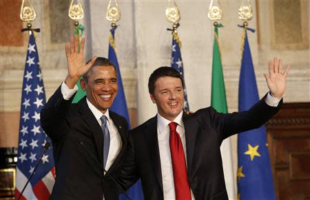 U.S. President Obama and Italian Prime Minister Renzi wave at the end of their conference following their meeting at Villa Madama in Rome