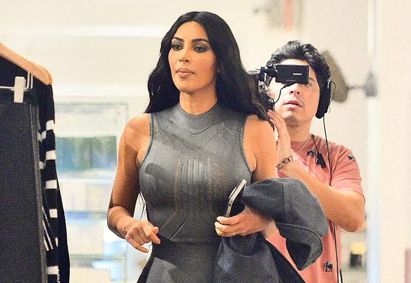 new arrival 860e3 d8fc2 Kim Kardashian Goes Shopping in an Ultraskintight, Futuristic Catsuit With  Pointy Yeezy Boots
