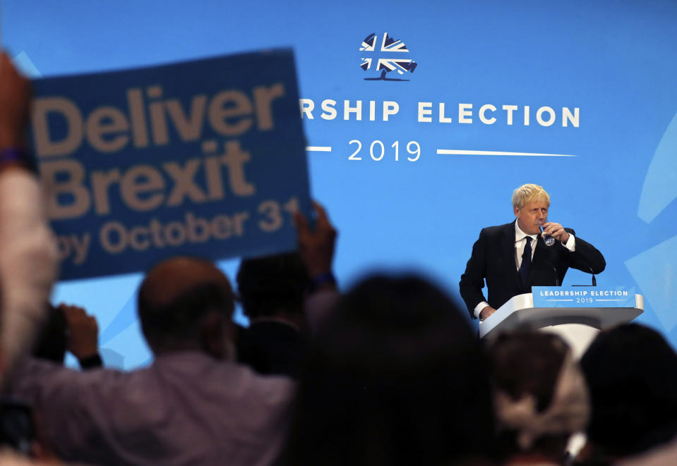 Conservative party leadership candidate Boris Johnson pause while delivering his speech during a Conservative leadership hustings at ExCel Centre in London, Wednesday, July 17, 2019. The two contenders, Jeremy Hunt and Boris Johnson are competing for votes from party members, with the winner replacing Prime Minister Theresa May as party leader and Prime Minister of Britain's ruling Conservative Party. (AP Photo/Frank Augstein)