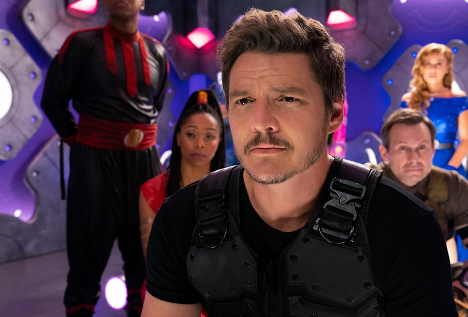 "Pedro Pascal (center) stars as the leader of a group of adult superheroes who need to be saved by their kids in Netflix's ""We Can Be Heroes."""