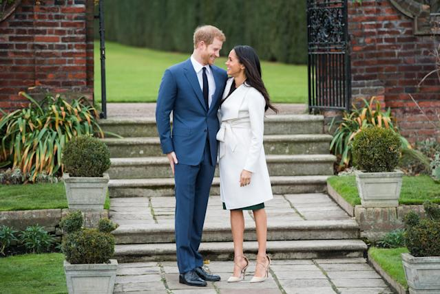 "<p>Meghan's look was way more buttoned up than her first photo op with Prince Harry at the Invictus Games. The actress was <a href=""https://www.yahoo.com/lifestyle/meghan-markle-shamed-wearing-ripped-jeans-155420729.html"" data-ylk=""slk:shamed for wearing ripped jeans;outcm:mb_qualified_link;_E:mb_qualified_link"" class=""link rapid-noclick-resp newsroom-embed-article"">shamed for wearing ripped jeans</a>. But theirs is a modern royal romance. She's been married before, so <a href=""https://www.yahoo.com/lifestyle/people-explains-meghan-markle-married-130656635.html"" data-ylk=""slk:look for them to have a much more low-key wedding;outcm:mb_qualified_link;_E:mb_qualified_link"" class=""link rapid-noclick-resp newsroom-embed-article"">look for them to have a much more low-key wedding</a> than Prince William and Kate Middleton had. Being the ""spare"" and not the heir allows for that, anyway. (Photo: Chris Jackson/Getty Images) </p>"
