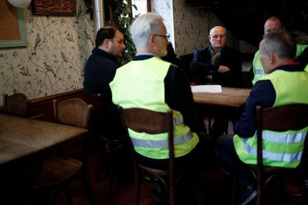 FILE PHOTO: Jacques Drouhin, mayor of Flagy, speaks with yellow vests movement members at a cafe in Flagy, France, January 9, 2019.  Picture taken January 9, 2019.  REUTERS/Benoit Tessier/File Photo