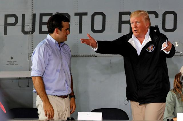 <p>President Donald Trump talks with Puerto Rico Governor Ricardo Rosselló as they take their seats for a briefing on hurricane relief efforts in a hangar at Muniz Air National Guard Base in Carolina, Puerto Rico, Oct. 3, 2017. (Photo: Jonathan Ernst/Reuters) </p>