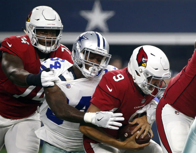 Arizona Cardinals quarterback Sam Bradford (9) is sacked by Dallas Cowboys defensive end Randy Gregory as Cardinals' D.J. Humphries (74) defends in the first half of an preseason NFL football game in Arlington, Texas, Sunday, Aug. 26, 2018. (AP Photo/Michael Ainsworth)