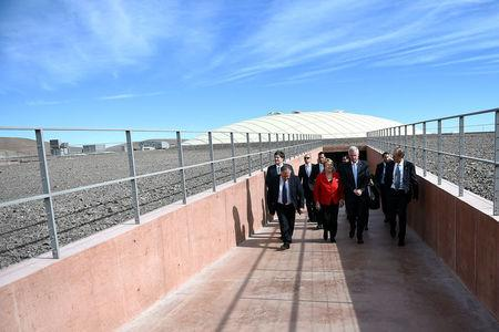 Chile's President Michelle Bachelet and Director General of the European Southern Observatory (ESO), Tim de Zeeuw walk at the construction site of the world's largest telescope in the desert of Atacama,  Chile,  May 26, 2017. Sebastian Rodriguez/Courtesy of Chilean Presidency/Handout via Reuters