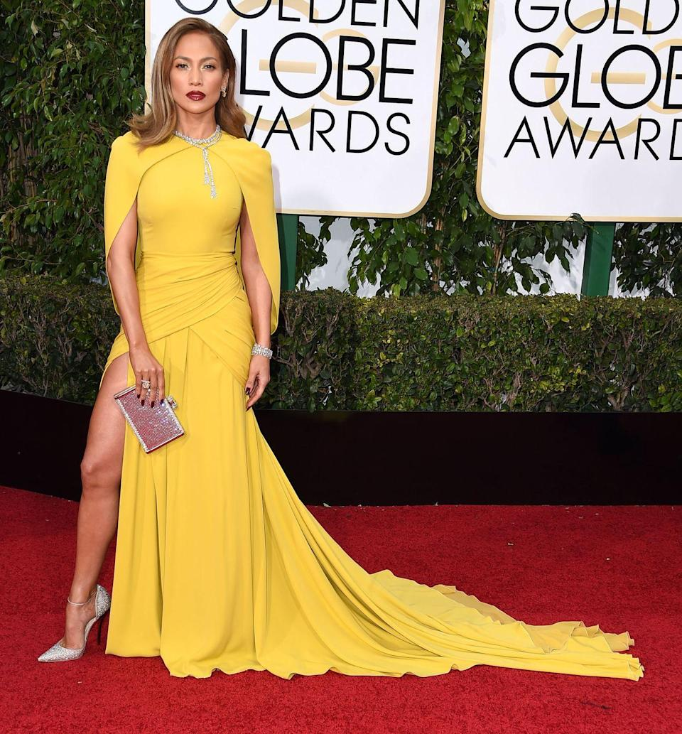 <p>J.Lo brightens the Golden Globes red carpet in this yellow Giambattista Valli number, silver heels and clutch, and statement necklace. </p>