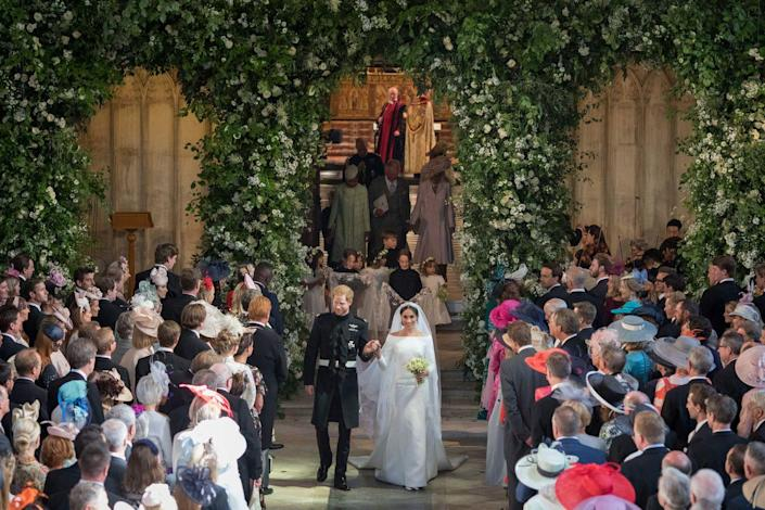 """<p>Though <a href=""""https://variety.com/2018/tv/news/prince-harry-meghan-markle-royal-wedding-windsor-1202813625/"""" rel=""""nofollow noopener"""" target=""""_blank"""" data-ylk=""""slk:600 people attended"""" class=""""link rapid-noclick-resp"""">600 people attended</a> Prince Harry and Meghan Markle's wedding inside St. George's Chapel at Windsor Castle, the bride had just one family member present. Her <a href=""""https://www.harpersbazaar.com/celebrity/latest/a20754831/meghan-markle-mother-doria-ragland-sitting-alone-royal-wedding/"""" rel=""""nofollow noopener"""" target=""""_blank"""" data-ylk=""""slk:mother, Doria Ragland"""" class=""""link rapid-noclick-resp"""">mother, Doria Ragland</a>, was the only person from <a href=""""https://www.harpersbazaar.com/celebrity/latest/a20981062/doria-ragland-meghan-markle-mom-royal-wedding-moment/"""" rel=""""nofollow noopener"""" target=""""_blank"""" data-ylk=""""slk:Meghan's clan"""" class=""""link rapid-noclick-resp"""">Meghan's clan</a> to make it to the royal wedding, but she looked seriously stunning throughout the day. Ragland was all Meghan needed by her side anyway.</p>"""