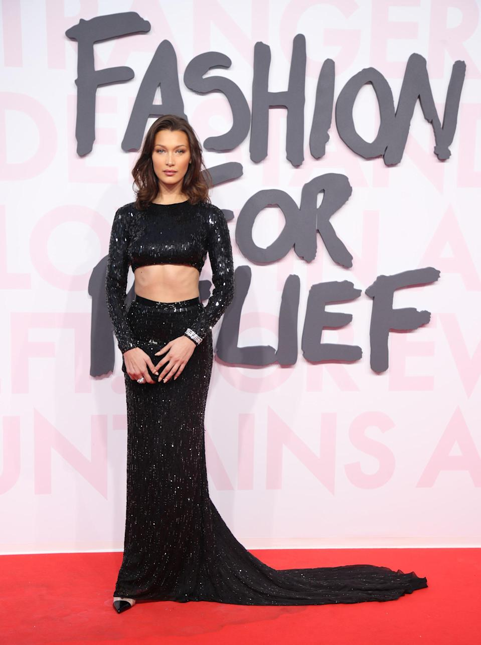 <p>At the annual Fashion For Relief Catwalk show held this year in Cannes, Bella Hadid wore a sequinned cut-out Julien Macdonald dress before hitting the catwalk. [Photo: Getty] </p>