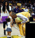 Kobe Bryant's daughter, Gianna, congratulates her father with a kiss as his wife Vanessa and daughter Natalia look on during the presentation ceremony of his first and only MVP award prior to Game 2 of the 2008 Western Conference semifinals. (Kevork Djansezian/AP Photo)