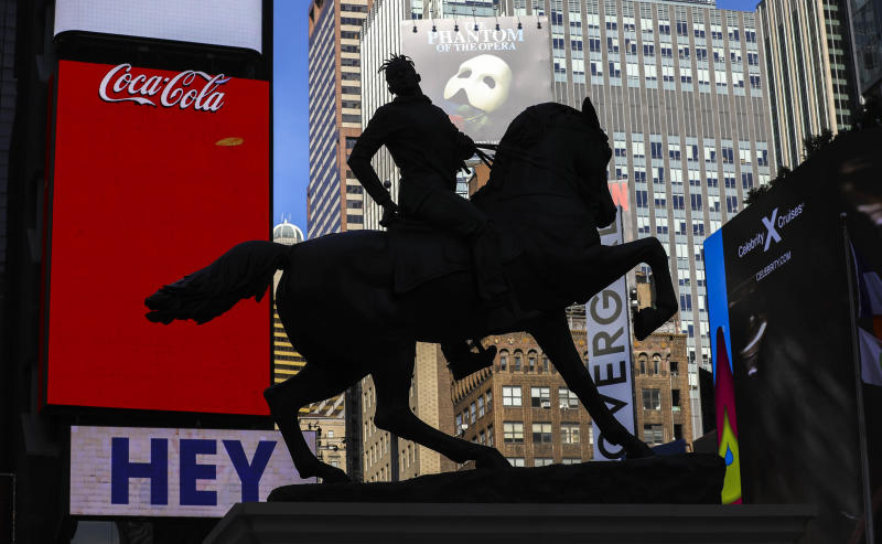 """A bronze sculpture, """"Rumors of War,"""" by artist Kehinde Wiley, appears in Times Square at an unveiling on Friday Sept. 27, 2019, in New York. The work, depicting of a young African American in urban streetwear sitting astride a galloping horse, will be exhibited through December 1.  (AP Photo/Bebeto Matthews)"""
