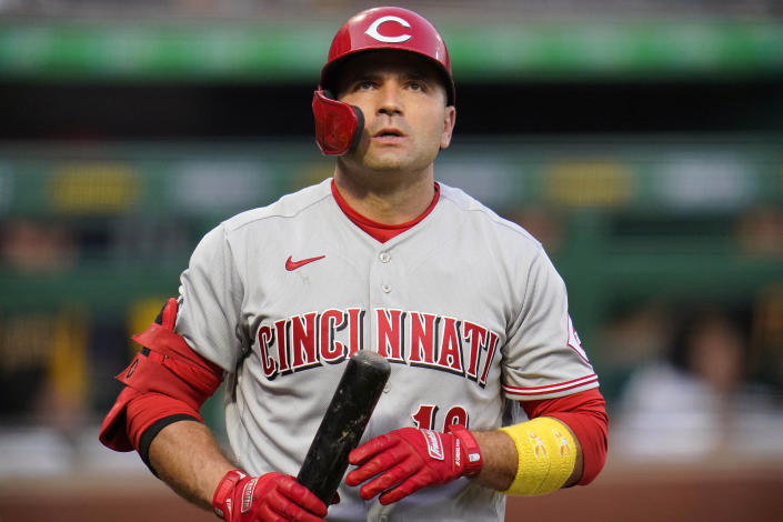 Cincinnati Reds' Joey Votto walks back to the dugout after striking out against Pittsburgh Pirates starting pitcher Dillon Peters during the second inning of a baseball game in Pittsburgh, Tuesday, Sept. 14, 2021. (AP Photo/Gene J. Puskar)
