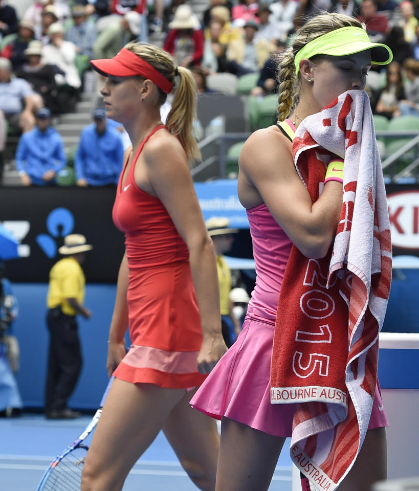 FILE - In this Jan. 27, 2015, file photo, Eugenie Bouchard, of Canada, right, and Maria Sharapova, of Russia, change ends during their quarterfinal match at the Australian Open tennis championship in Melbourne, Australia. If Bouchard had her way, Sharapova would have been banned from tennis for life. The 2014 Wimbledon finalist from Canada, who has been ranked as high as fifth in the world, called Sharapova a cheater upon the Russian's return from a 15-month doping suspension for using the banned substance meldonium. (AP Photo/Andy Brownbill, File)