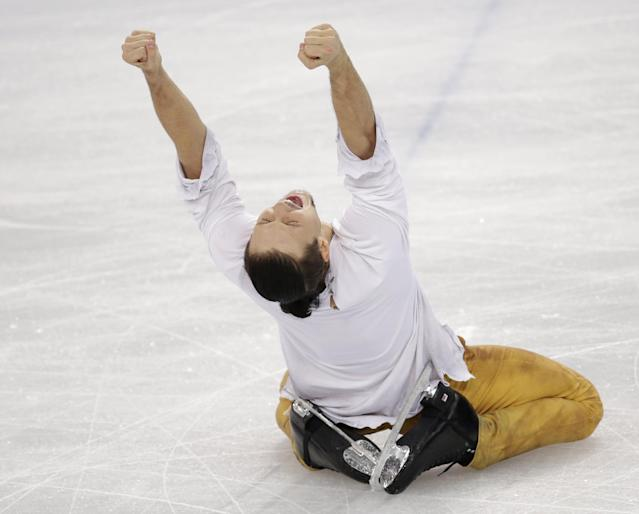 Fedor Klimov reacts after he and Ksenia Stolbova of Russia completed their routine in the pairs free skate figure skating competition at the Iceberg Skating Palace during the 2014 Winter Olympics, Wednesday, Feb. 12, 2014, in Sochi, Russia. (AP Photo/Bernat Armangue)