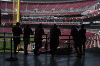 Fans stand in the concourse at Great American Ballpark prior to a baseball game between the Chicago Cubs and the Cincinnati Reds in Cincinnati on Sunday, May 2, 2021. (AP Photo/Jeff Dean)