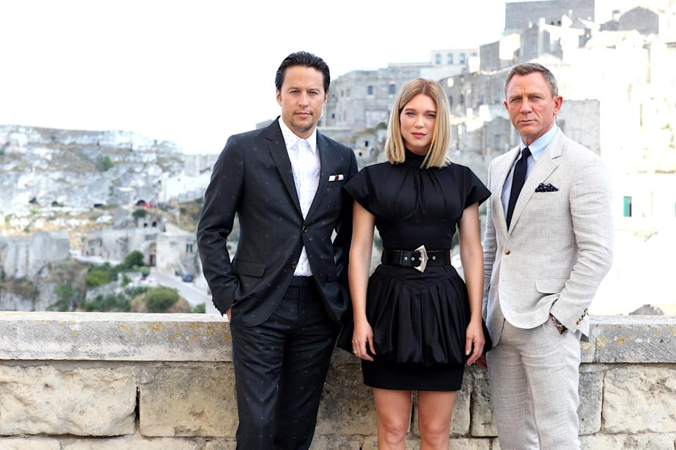 "MATERA, ITALY - SEPTEMBER 09: (LtoR) Director Cary Joji Fukunaga actress Léa Seydoux and actor Daniel Craig pose as they arrive on set of the James Bond last movie ""No Time To Die"" on September 09, 2019 in Matera, Italy. (Photo by Franco Origlia/Getty Images)"