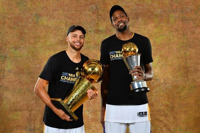 """Stephen Curry and <a class=""""link rapid-noclick-resp"""" href=""""/nba/players/4244/"""" data-ylk=""""slk:Kevin Durant"""">Kevin Durant</a> show the fruits of their labors. (Getty Images)"""