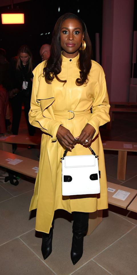 <p>Issa Rae went with a bold and bright yellow look at the Proenza Schouler show, completing her outfit with a white top-handle bag and black boots. She, too, opted for statement-making jewelry, adding a large gold hoop as the final touch.</p>