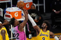 Miami Heat forward Jimmy Butler, left, shoots as Los Angeles Lakers guard Wesley Matthews defends during the first half of an NBA basketball game Saturday, Feb. 20, 2021, in Los Angeles. (AP Photo/Mark J. Terrill)