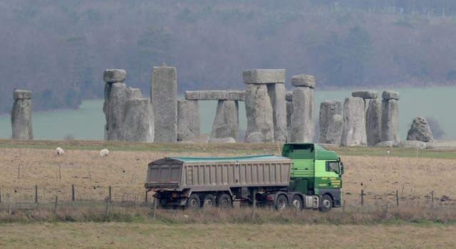 Traffic passing Stonehenge on the A303 road in Wiltshire