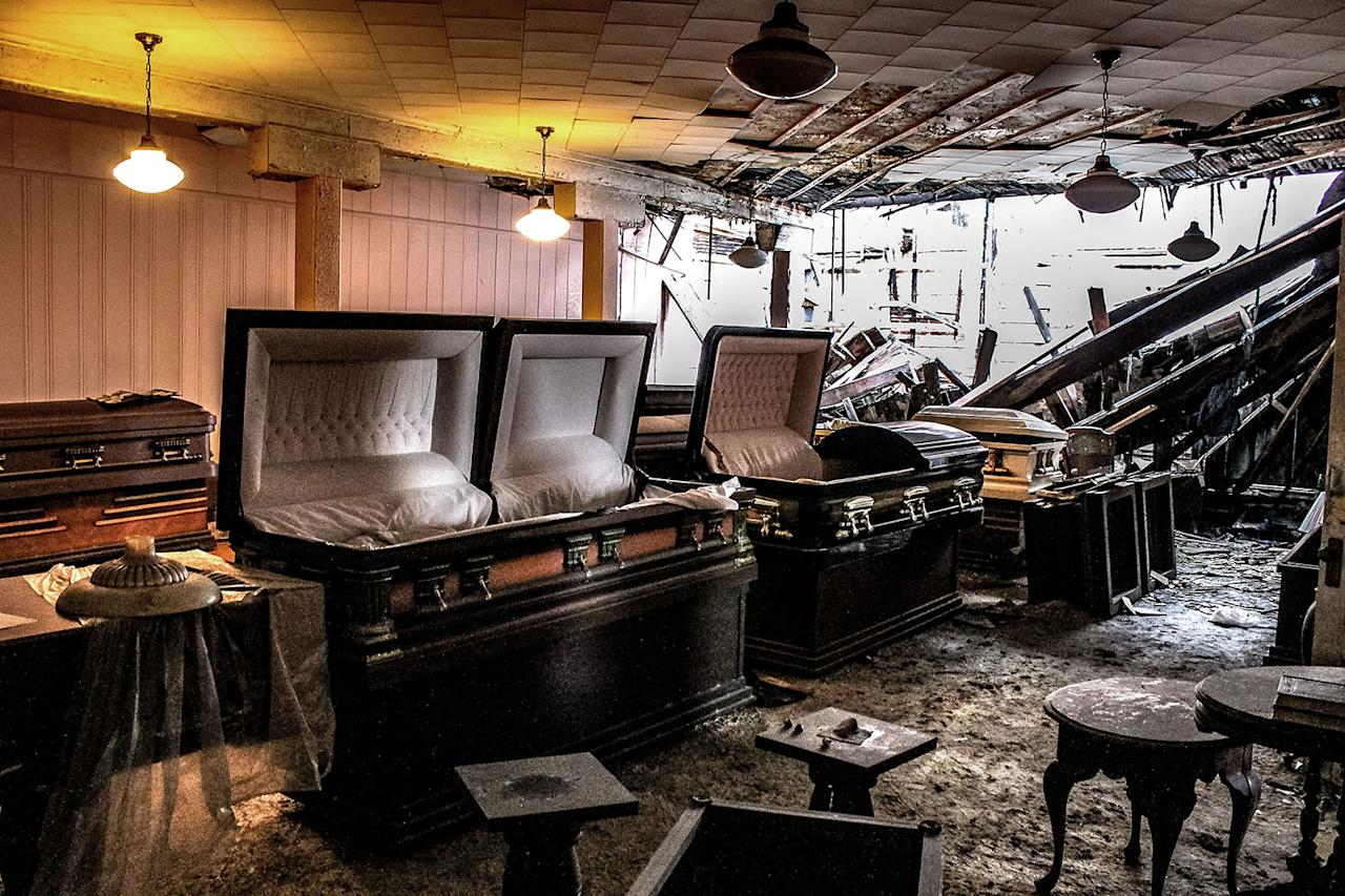<p>Old and empty coffins which were left to rot in an abandoned funeral home in Jacksonville, Fla. (Photo: Abandoned Southeast/Caters News) </p>