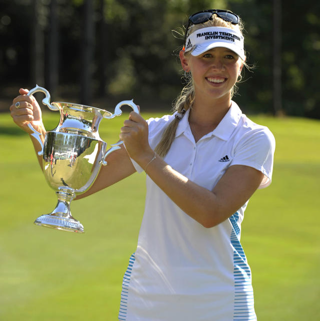 Jessica Korda holds up the trophy following her win in the Airbus LPGA Classic golf tournament at Magnolia Grove on Sunday, May 25, 2014, in Mobile, Ala. (AP Photo/G.M. Andrews)