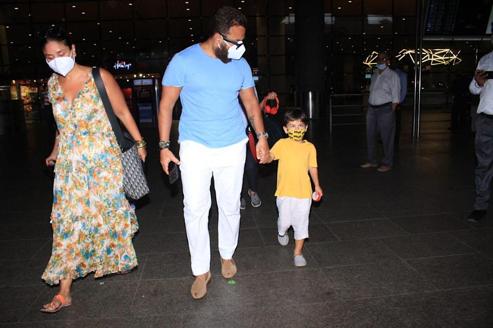 """<div class=""""paragraphs""""><p>Kareena Kapoor, Saif and Taimur spotted at the airport as they return from their beach vacation.</p></div>"""