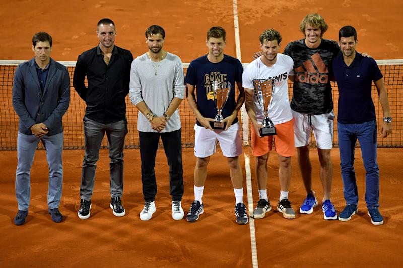 (from left to right) Serbian tennis player Dusan Lajovic, Serbian tennis player Viktor Troicki, Bulgarian tennis player Grigor Dimitrov, Serbian tennis player Filip Krajinovic, Austrian tennis player Dominic Thiem, German tennis player Alexander Zverev and Serbian tennis player Novak Djokovic pose for a group photo after the final match between Austrian tennis player Dominic Thiem and Serbian tennis player Filip Krajinovic at the Adria Tour, Novak Djokovic's Balkans charity tennis tournament in Belgrade on June 14, 2020. - The ATP and WTA Tours have been suspended since March due to the COVID-19 pandemic and will not resume at least until the end of July 2020. (Photo by Andrej ISAKOVIC / AFP) (Photo by ANDREJ ISAKOVIC/AFP via Getty Images)