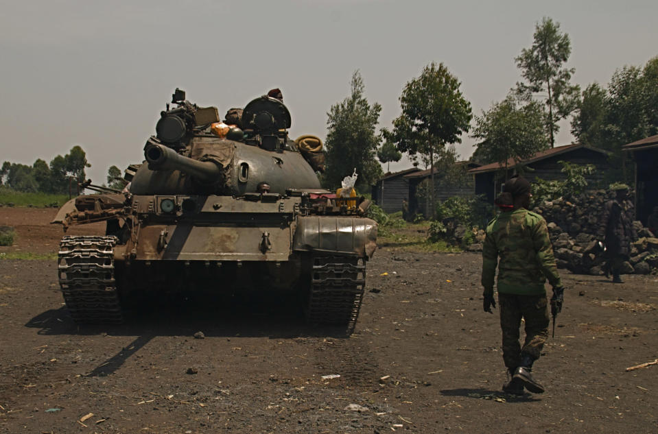 A Congolese government tank prepares to deploy for fighting against M23 rebels, at an operating base in Kanyaruchinya, north of Goma, eastern Congo, Friday, Aug. 23, 2013. Congo's government accused Rwanda on Friday of supporting a rebel attack on Goma after mortar rounds killed a mother and her three children and damaged a church in the eastern Congo border city. (AP Photo/Joseph Kay)