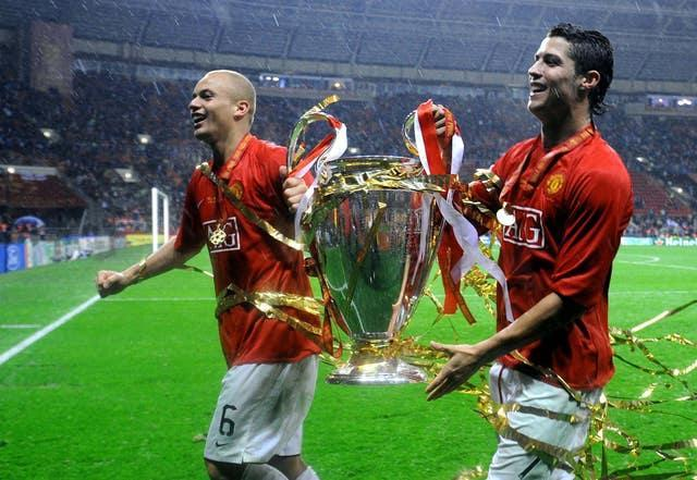 Cristiano Ronaldo celebrates with Wes Brown following the Champions League win in 2008.