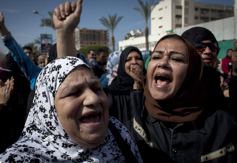 Female protesters chant anti-President Mohammed Morsi slogans in front of the main court house during the fifth day of a general strike, in Port Said, Egypt, Thursday, Feb. 21, 2013. (AP Photo/Nasser Nasser)