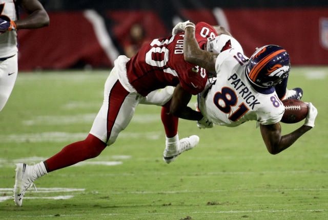 Denver Broncos wide receiver Tim Patrick, right, catches a pass under pressure from Arizona Cardinals defensive back Rudy Ford during the first half of a preseason NFL football game Thursday, Aug. 30, 2018, in Glendale, Ariz. (AP Photo/Rick Scuteri)