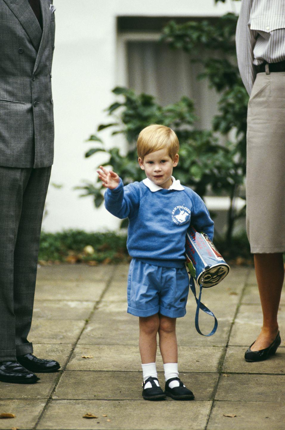 <p>Believe it or not, a tiny Prince Harry is not in a school uniform here - he was just dressed in very well matching clothes. On September 16 1987, Prince Harry took his first steps into the world of nursery, and he looked confident, starting out with a wave to the waiting media.</p>