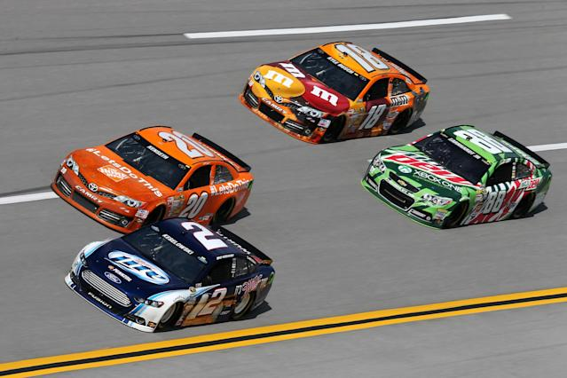 TALLADEGA, AL - OCTOBER 18: Brad Keselowski, driver of the #2 Miller Lite Ford, Matt Kenseth, driver of the #20 The Home Depot Toyota, Kyle Busch, driver of the #18 M&M's Halloween Toyota, and Dale Earnhardt Jr., driver of the #88 Mountain Dew / XBox One Chevrolet, practice for the NASCAR Sprint Cup Series 45th Annual Camping World RV Sales 500 at Talladega Superspeedway on October 18, 2013 in Talladega, Alabama. (Photo by Rob Carr/Getty Images)