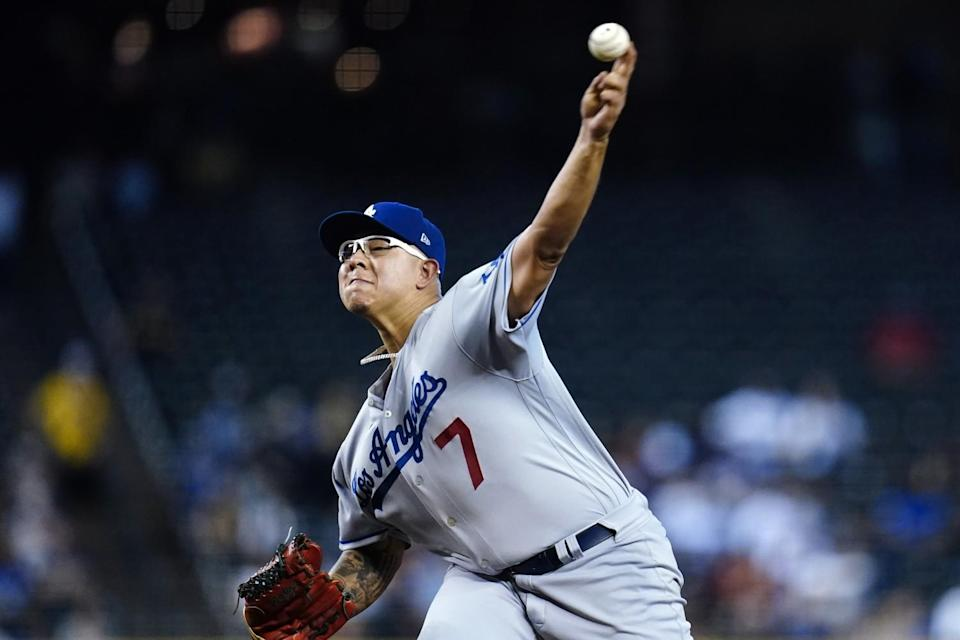 Dodgers starting pitcher Julio Urías delivers during the first inning Sunday.