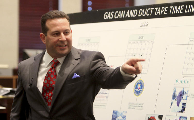 """FILE - In this July 3, 2011 file photo, defense attorney Jose Baez points in the direction of the prosecution table during his closing arguments in the Casey Anthony murder trial in Orlando, Fla.. Baez says he originally considered Anthony pleading guilty to a lesser charge to avoid the death penalty if convicted of murdering her 2-year-old daughter Caylee. In his just-released book """"Presumed Guilty, Casey Anthony: The Inside Story,"""" Baez wrote that prosecutors offered the Orlando mother a plea deal in 2008. He told The Associated Press this week that Anthony """"would not entertain it for a second."""" Anthony was acquitted last summer of all charges except for four misdemeanors of lying to investigators.(AP Photo/Red Huber, Pool)"""