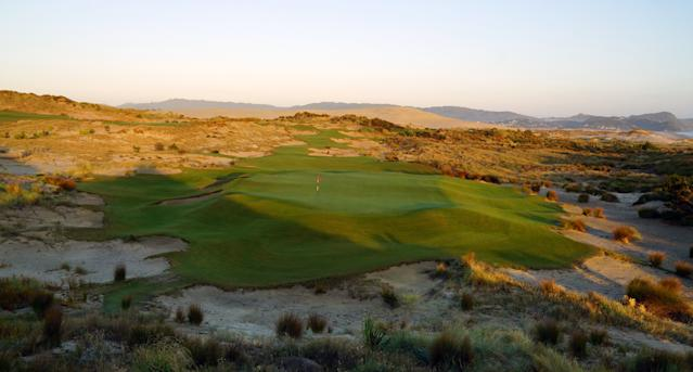 "<div class=""caption""> A look at the 180-yard par-3 15th at sunset </div>"