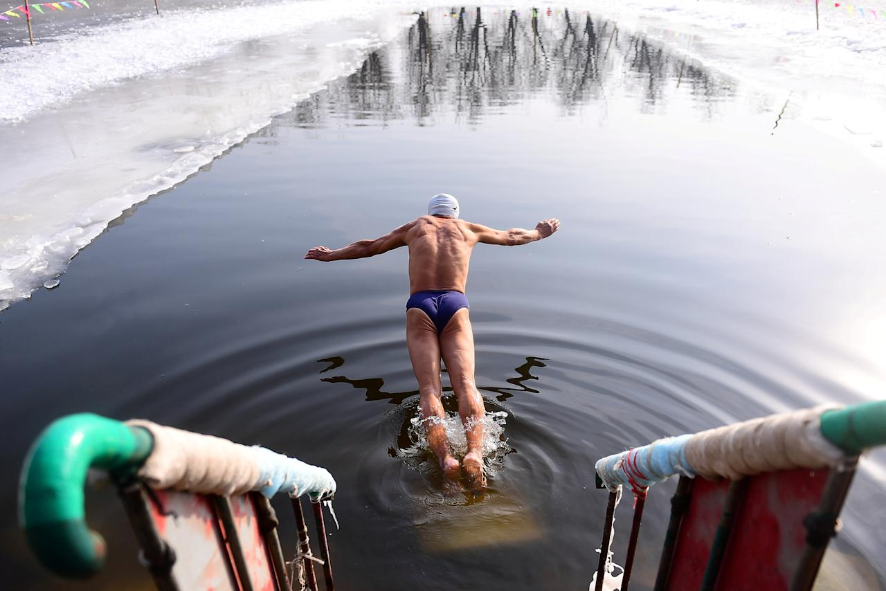 <p>A winter swimmer dives into icy waters at a park in Shenyang, Liaoning province, China January 11, 2019. REUTERS/Stringer ATTENTION EDITORS – THIS IMAGE WAS PROVIDED BY A THIRD PARTY. CHINA OUT. TPX IMAGES OF THE DAY </p>