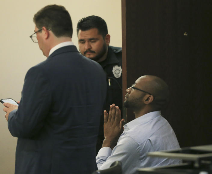 Otis McKane clasps his hands together right before he elbowed a bailiff who was attempting to handcuff him after the jury delivered a guilty verdict in his capital murder trial for the shooting of San Antonio police detective Benjamin Marconi on Monday, July 26, 2021, in San Antonio. (Kin Man Hui/The San Antonio Express-News via AP)