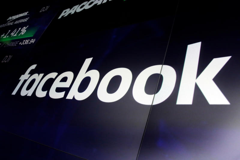 """In this March 29, 2018, photo, the logo for Facebook appears on screens at the Nasdaq MarketSite, in New York's Times Square. New Zealand's official privacy watchdog has described Facebook as """"morally bankrupt"""" and suggested his country follow neighboring Australia's lead by making laws that could jail executives over streamed violence such as the Christchurch mosque shootings. (AP Photo/Richard Drew, File)"""