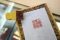 It might seem paradoxical in a country often assumed to be a futuristic tech-savvy paradise, but Japan's business world and bureaucracy remain heavily dependent on paper documents, hand-stamped with approval
