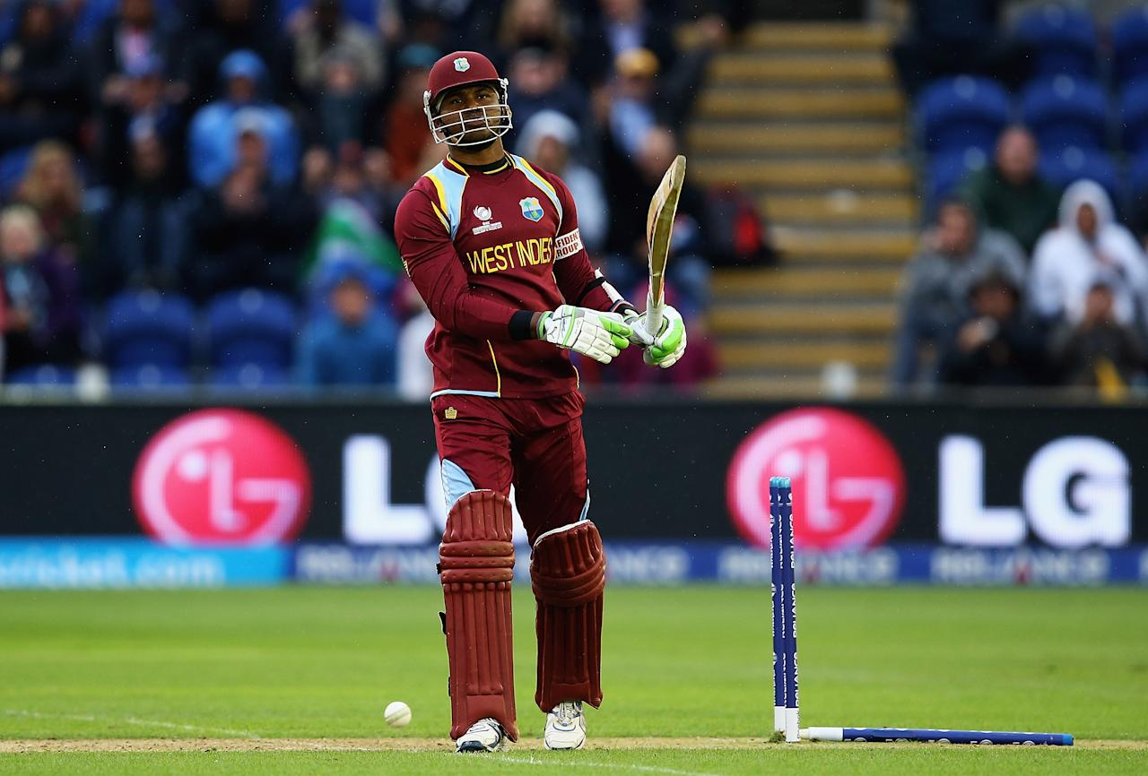CARDIFF, WALES - JUNE 14:  Marlon Samuels of the West Indies looks on, after he was bowled by dale Steyn of South Africa during the ICC Champions Trophy Group B match between West Indies and South Africa at SWALEC Stadium on June 14, 2013 in Cardiff, Wales.  (Photo by Matthew Lewis-ICC/ICC via Getty Images)