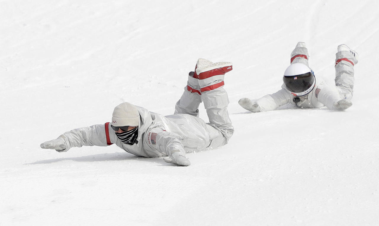 <p>United States snowboard team members slide down the hill after the men's Big Air snowboard competition at the 2018 Winter Olympics in Pyeongchang, South Korea, Saturday, Feb. 24, 2018. (AP Photo/Matthias Schrader) </p>