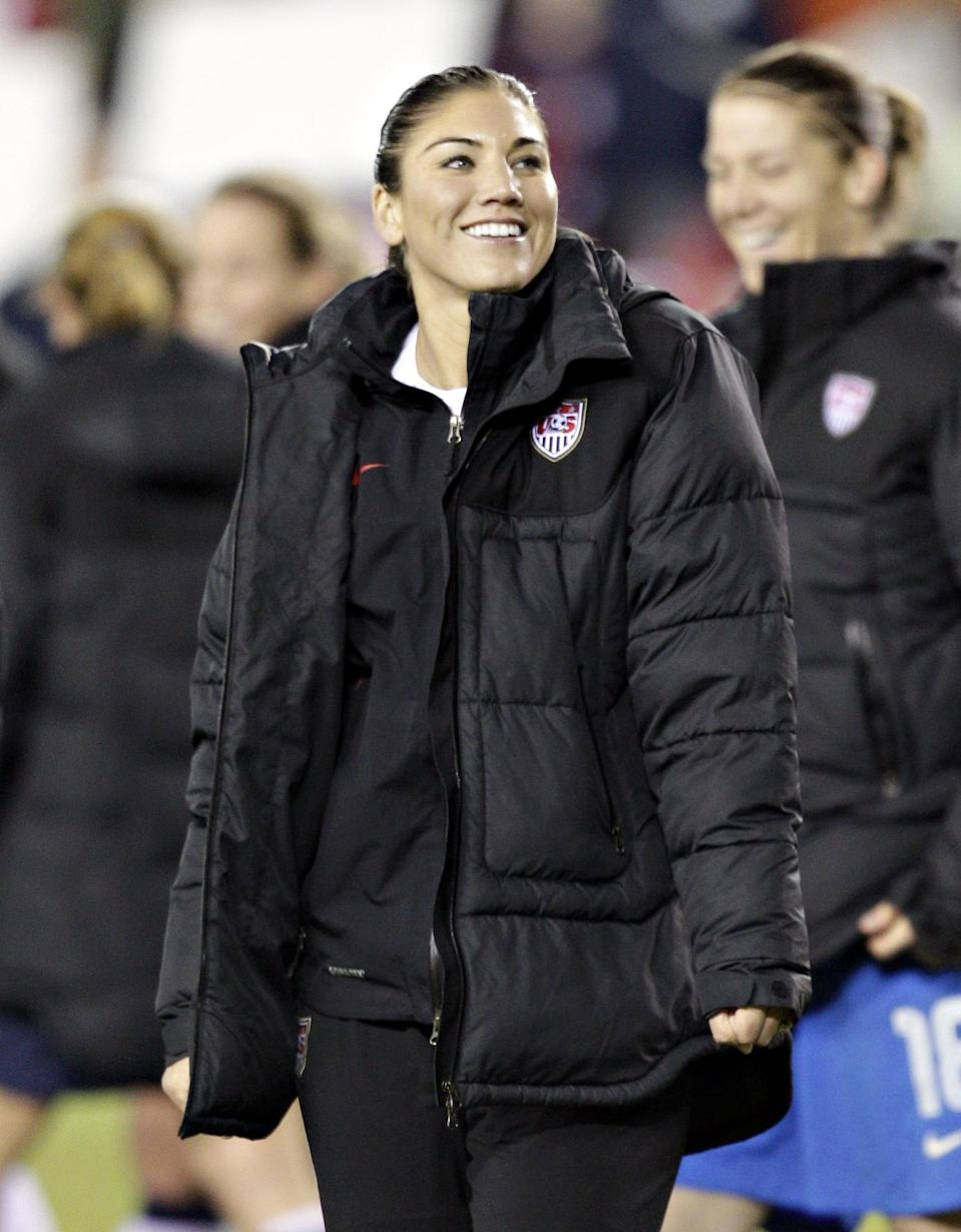 HOUSTON, TX - DECEMBER 12: Hope Solo (1) leads her team off the field after defeating China at BBVA Compass Stadium on December 12, 2012 in Houston, Texas. USA won 4-0. (Photo by Bob Levey/Getty Images)