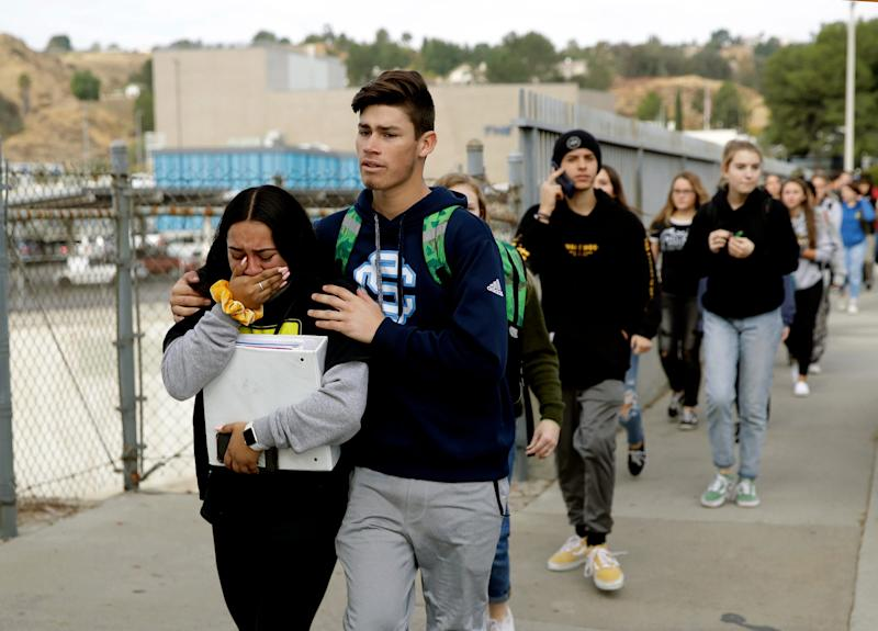 Students are escorted out of Saugus High School after a shooting Nov. 14 in Santa Clarita, Calif.