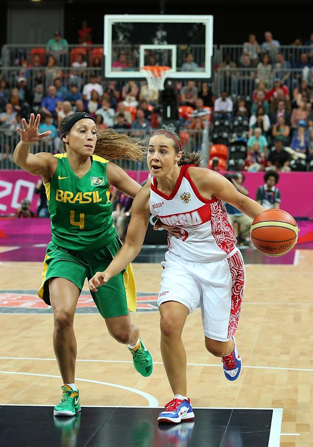 LONDON, ENGLAND - JULY 30: Becky Hammon #9 of Russia drives the ball past Adriana Pinto #4 of Brazil during the Women's Basketball Preliminary Round match on Day 3 at Basketball Arena on July 30, 2012 in London, England. (Photo by Christian Petersen/Getty Images)