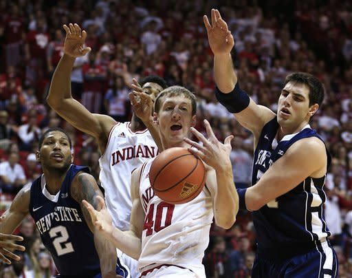 Indiana's Cody Zeller (40) and Penn State's Sasa Borovnjak (21) and D.J. Newbill (2) battle for a rebound during the first half of an NCAA college basketball game, Wednesday, Jan. 23, 2013, in Bloomington, Ind. (AP Photo/Darron Cummings)